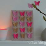 DIY-Idee halbachblog: Bild auf Stoff mit aufgenähten Papierschmetterlingen
