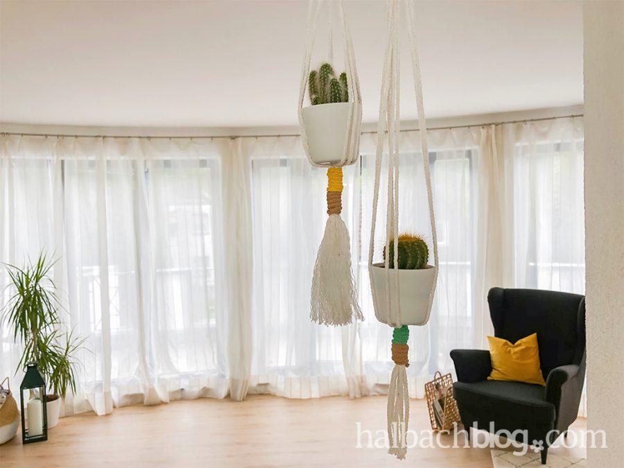 Lässig abhängen: Pflanzenampel aus Papier-Strickschlauch